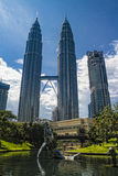 Petronas Towers and office building in asian city Stock Images