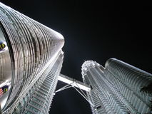 Petronas towers. Looking up at the twin petronas towers in Kuala Lumpur, Malaysia Royalty Free Stock Photo