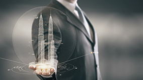 Petronas Towers Businessman holding in Hand Landmark New technologies. Businessman in the future with futuristic technology with landmark stock footage