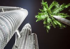 Petronas Towers(Twin tower) and coconut palm Royalty Free Stock Image