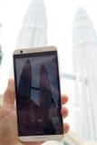 Petronas Towers. KUALA LUMPUR, MALAYSIA - AUGUST 18,2016: Tourist makes photo of Petronas Towers on HTC smart phone Stock Photos