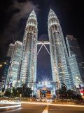 Petronas Towers in Malaysia. A vertical panorama of the famous Petronas Towers taken at New Year`s Eve with car light trails in front Stock Image