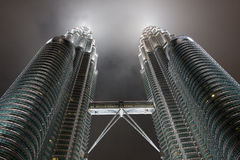 Petronas Towers - modern business architecture. Kuala Lumpur, Malaysia-December 30, 2010:in Petronas, Twin Towers, Tallest building in Asia, Kuala Lumpur royalty free stock image