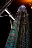 Petronas Towers at night. Another view of the Petronas twin towers at night showing only one tower and the sky bridge Royalty Free Stock Image
