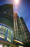 Petronas towers at night. Petronas towers from a low angle with a street lamp flare Stock Photo