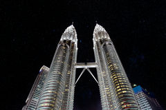 Petronas Towers at night with stars. Petronas Towers at night in Kuala Lumpur with dazzling stars Stock Images