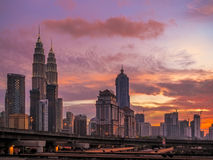 Petronas Towers at Sunset and Blue Hour Stock Photos