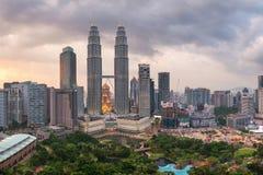 Petronas towers on sunset in Kuala Lumpur Stock Images