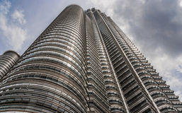 Petronas Towers at wide angle in Kuala Lumpur Stock Images
