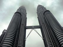 Petronas Twin Tower in Clouds Stock Images