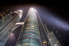 Petronas twin tower at night on a raily night Royalty Free Stock Photo