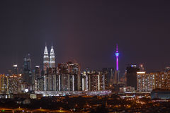 Petronas twin towers - city night view. Once the world`s tallest, these 88-story towers bear a modern Islamic design Stock Photo