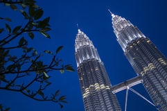 PETRONAS Twin Towers at dusk. PETRONAS Twin Towers in the evening Royalty Free Stock Photos