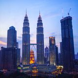 Petronas Twin Towers fondly known as KLCC and the surrounding buildings at evening Royalty Free Stock Photography