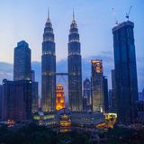 Petronas Twin Towers fondly known as KLCC and the surrounding buildings at evening Stock Images