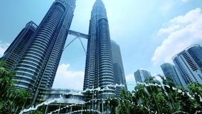 The Petronas Twin Towers with fountain at front. Kuala Lumpur, Malaysia stock video footage