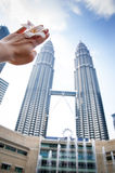 PETRONAS TWIN TOWERS OF THE HAND AND FLOWERS Stock Photos