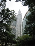 Petronas Twin Towers KL. View through trees of Petronas Twin Towers Kuala Lumpur Malaysia Stock Photo