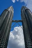 Petronas Twin Towers KLCC and sky bridge over deep blue sky and big cloud stock photography