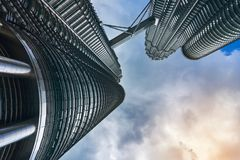 Petronas Twin Towers KLCC and sky bridge over deep blue sky and big cloud royalty free stock photos