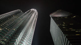 Petronas Twin Towers Kuala Lumpur. Nightshot with the moon shine against the dark sky background Royalty Free Stock Photo