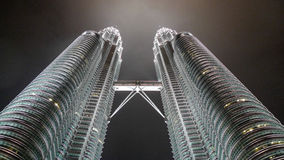 Petronas Twin Towers Kuala Lumpur. Nightshot with the moon shine against the dark sky background Royalty Free Stock Photography