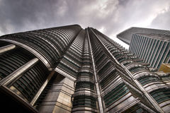 Petronas twin towers. Once the world`s tallest, these 88-story towers bear a modern Islamic design Royalty Free Stock Image