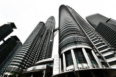 Petronas twin towers. Once the world`s tallest, these 88-story towers bear a modern Islamic design Royalty Free Stock Images