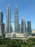 Petronas twin towers. A shot of Kuala Lumpur sky scrappers showing the famous Petronas twin towers taken in mid day Stock Photography