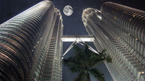Petronas Twin Towers. Skyscrapers, the pursuit of the stars, the moon and the stars, the night sky, palm, reach for the stars, even a little bit Royalty Free Stock Photography