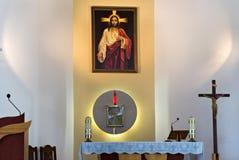 PETROPAVL KASAKHSTAN - JULI 24, 2015: Inre av Roman Catholic Church av den mest sakrala hjärtan av Jesus i Petropavl Fotografering för Bildbyråer