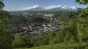 Summer panoramic view of Petropavlovsk City on background of volcanoes Royalty Free Stock Photo