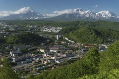 Summer top view of Petropavlovsk Kamchatsky City on background of volcanoes Stock Photography