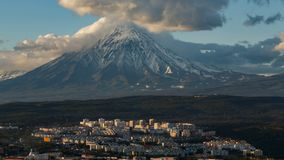 Petropavlovsk-Kamchatsky City on background Koryak Volcano stock footage