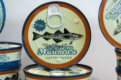 Tin cans natural liver pollock fish standing for sale at seafood market. PETROPAVLOVSK KAMCHATSKY CITY, KAMCHATKA PENINSULA, RUSSIAN FAR EAST - 2 DEC, 2018: Tin royalty free stock photos