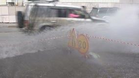 Automobiles driving over deep muddy puddle and splashing water. PETROPAVLOVSK KAMCHATSKY CITY, KAMCHATKA PENINSULA, RUSSIAN FAR EAST - 12 MAY, 2018: Automobiles stock video