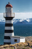 Petropavlovsk Lighthouse on coast of Pacific Ocean. Petropavlovsk-Kamchatsky City. Petropavlovsky Lighthouse founded in 1850 is located on Mayachny Cape on Stock Photography