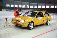Petrov and Vereshagin in racing car on ice in sports complex Royalty Free Stock Photo