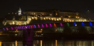 Petrovaradin Fortress at night. Petrovaradin Fortress as seen above the Rainbow Bridge at night. Novi Sad, Serbia Stock Photos