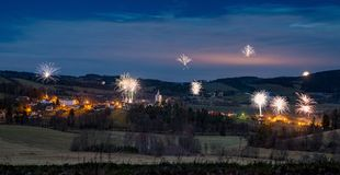 Petrovice mountain village, Czech republic at night. Petrovice mountain village near Sušice, Czech republic at night, New year eve celebration fireworks Stock Photo