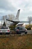 Petrovice Ustecky kraj, Tjeckien - december 10, 2016: svart bil Opel Astra som parkeras nära trafikflygplantupoleven T-104 som en Fotografering för Bildbyråer