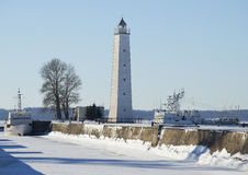Petrovsky channel and lighthouse on a sunny winter day. Kronstadt Stock Photo