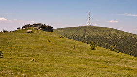 Petrovy kameny stones and Praded hill in Jeseniky mountains Stock Images