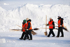 PETROZAVODSK, RUSSIA � FEBRUARY 18: janitors with shovels and br Stock Image
