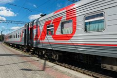 PETROZAVODSK, Passenger fast train awaits passengers. PETROZAVODSK, RUSSIA - JUNE 23, 2018: Passenger fast train awaits passengers at the railway station of royalty free stock photos