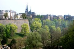 Petrusse Park and uptown of Luxembourg City. Petrusse Park in Luxembourg City lies in the valley of the River Petrusse between the upper town and the Bourbon Stock Image