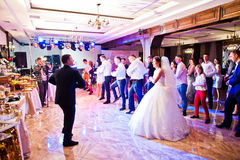 Petryky, Ukraine - May 14, 2016: Dance wedding party with guests. And leading toastmaster Royalty Free Stock Photo
