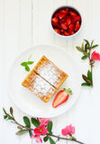 Pets (Belgian) waffles with strawberries Stock Photo
