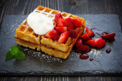 Pets (Belgian) waffles with strawberries. And whipped cream Stock Image