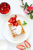 Pets (Belgian) waffles with strawberries Royalty Free Stock Photos